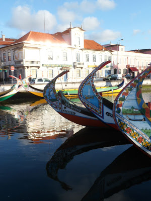 Painted boats on the river in Art Nouveau treasure-trove Aveiro