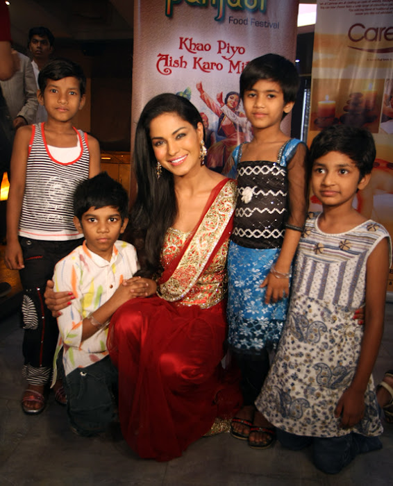 veena malik adopts payal kamble seven year old girl latest photos