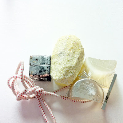 A swatch of house objects.  Sponge, Chocolate box, Elasticated string and a biscuit cutter.