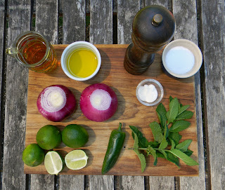raw ingredients for salsa criolla on cutting board