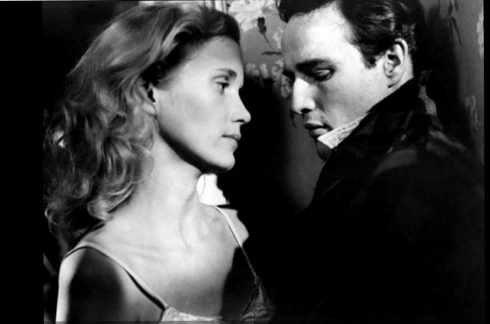 edie doyle Terry malloy (marlon brando) and edie doyle (eva marie saint) go for a chilly  park walk in on the waterfront -- on the waterfront: the criterion collection.