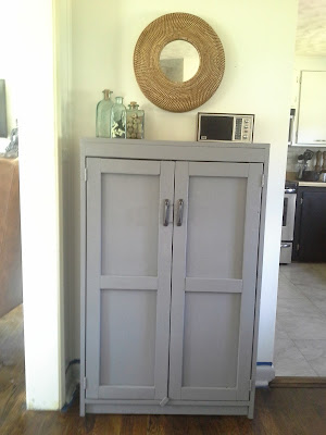 Grey cabinet dining room