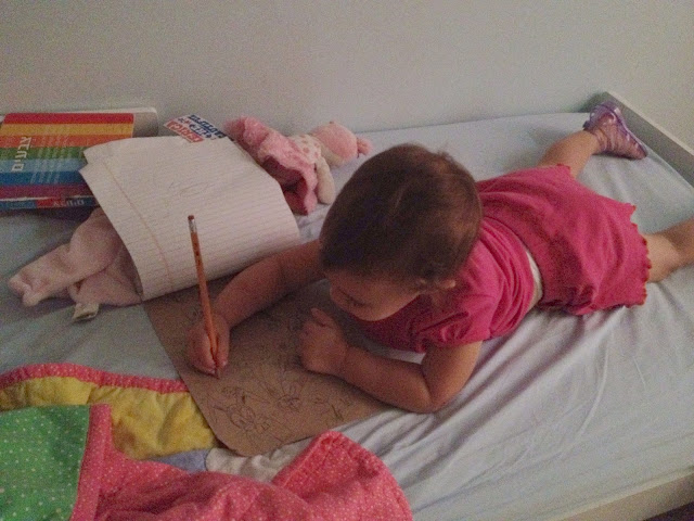 baby girl drawing in bed