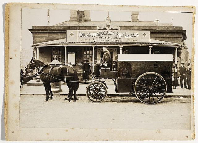 Horsedrawn ambulance outside Civil Ambulance & Transport Brigade headquarters, corner of George & Pitt Sts opposite the Benevolent Asylum, now Central Square, c. 1900, by unknown photographer.