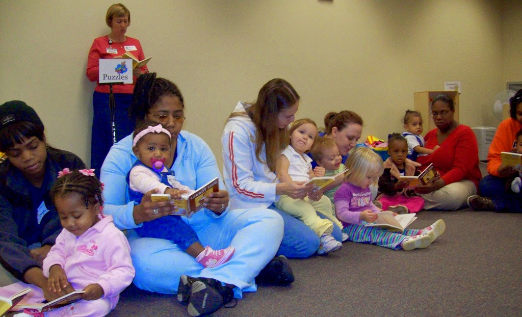 photo of BPL event that shows mothers reading to their toddlers