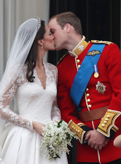 The future King of England and his beautiful bride capped their fairy tale wedding Friday with a chaste kiss on the balcony of Buckingham Palace.