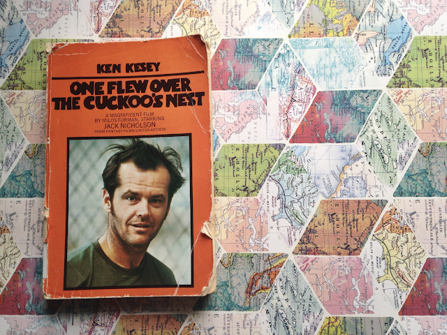 An old edition of One Flew Over the Cuckoo's Nest on a map background.