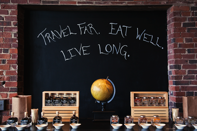 A chalkboard in a store in Portland, Maine reads 'Travel far. Eat well. Live long.'