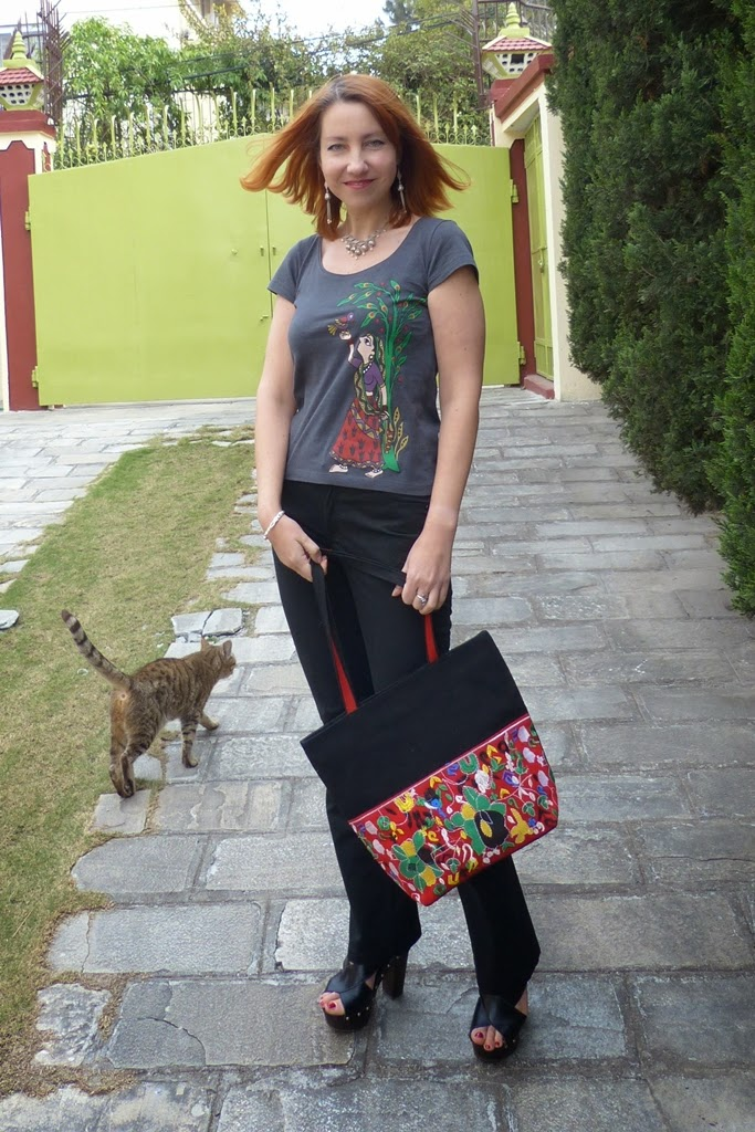Madhubani style print t-shirt, black pants and embroidered cotton bag
