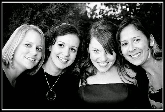 four smiling women