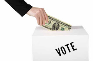 money being inserted in ballot box