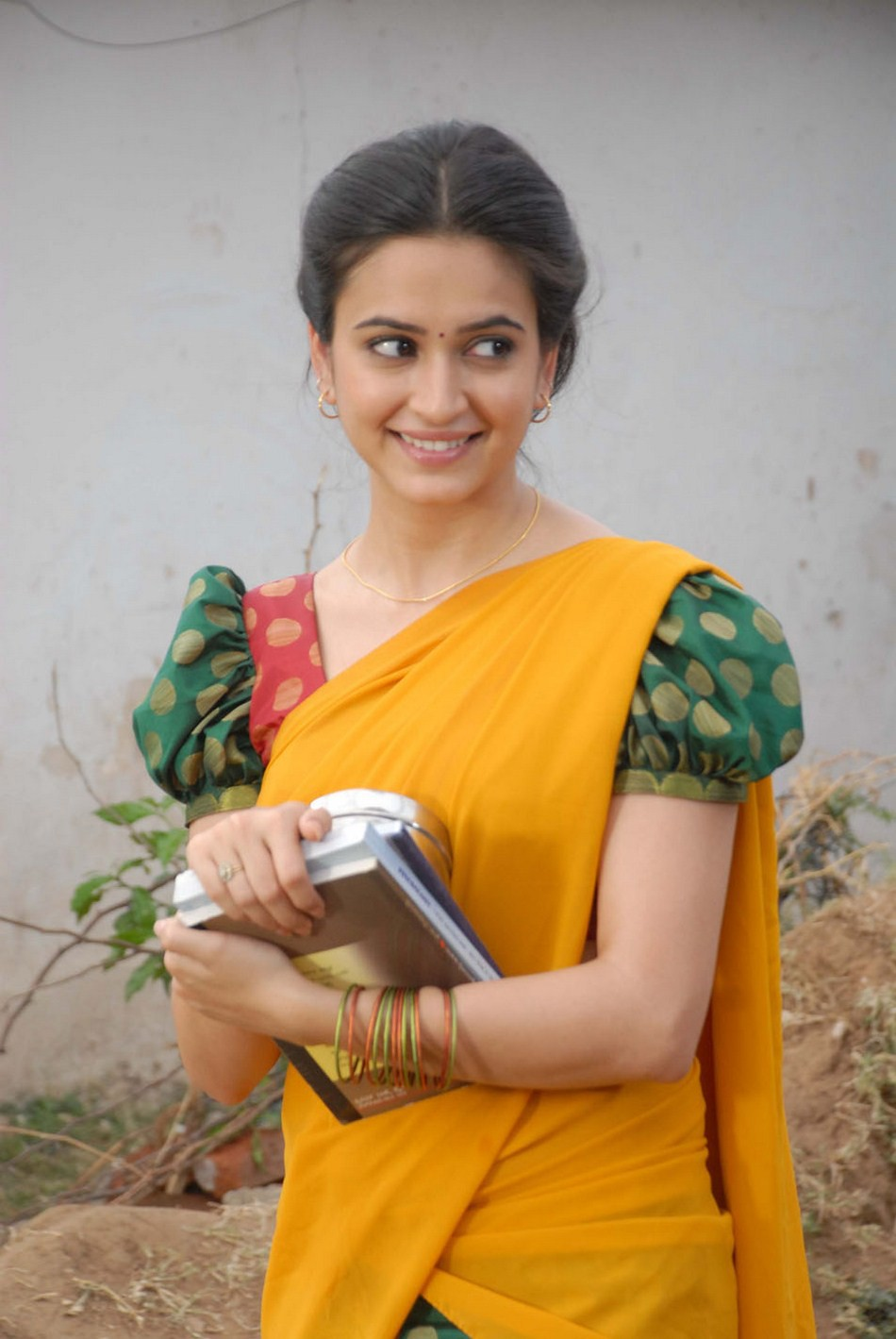 Kriti Kharbanda Cute Stills In Yellow Half Saree