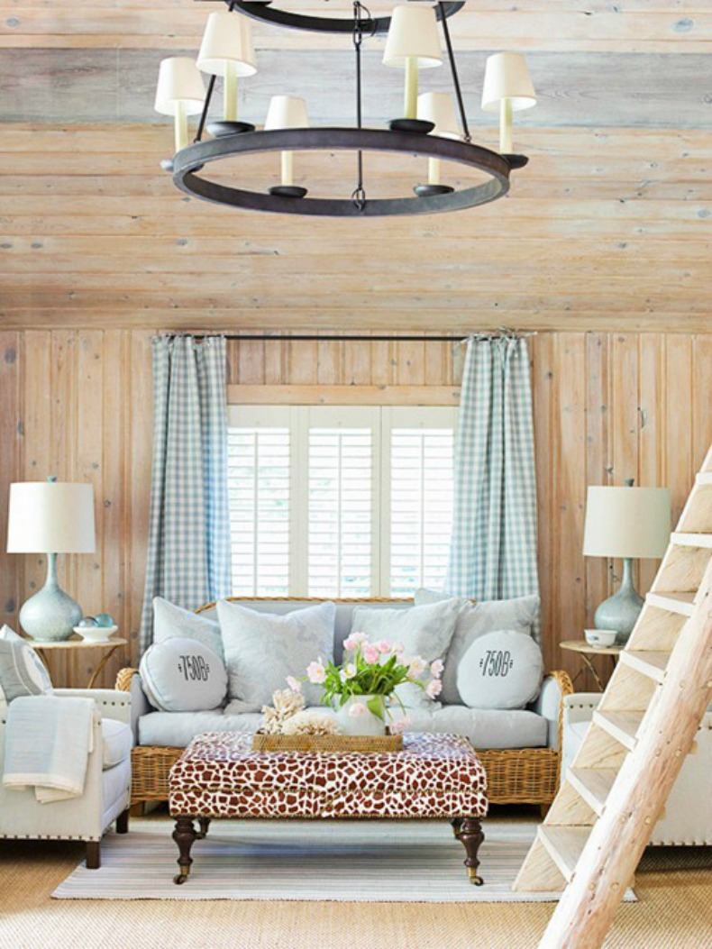 coastal cottage living room with wicker sofa and white upholstered club chair