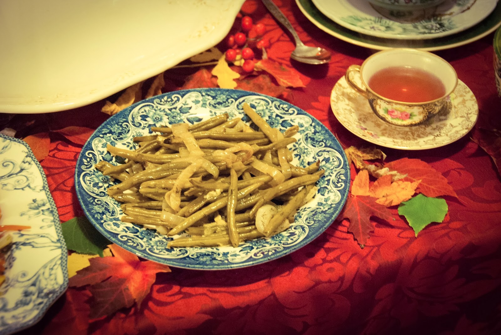 thanksgiving dinner roasted vegetables string beans tablecloth leaves tea