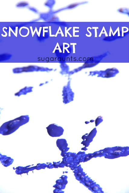 Snowflake stamp art with pipe cleaners and blue paint. This is a great winter craft!