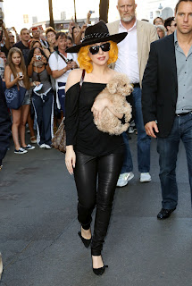 Lady Gaga in leather pants and bright yellow locks
