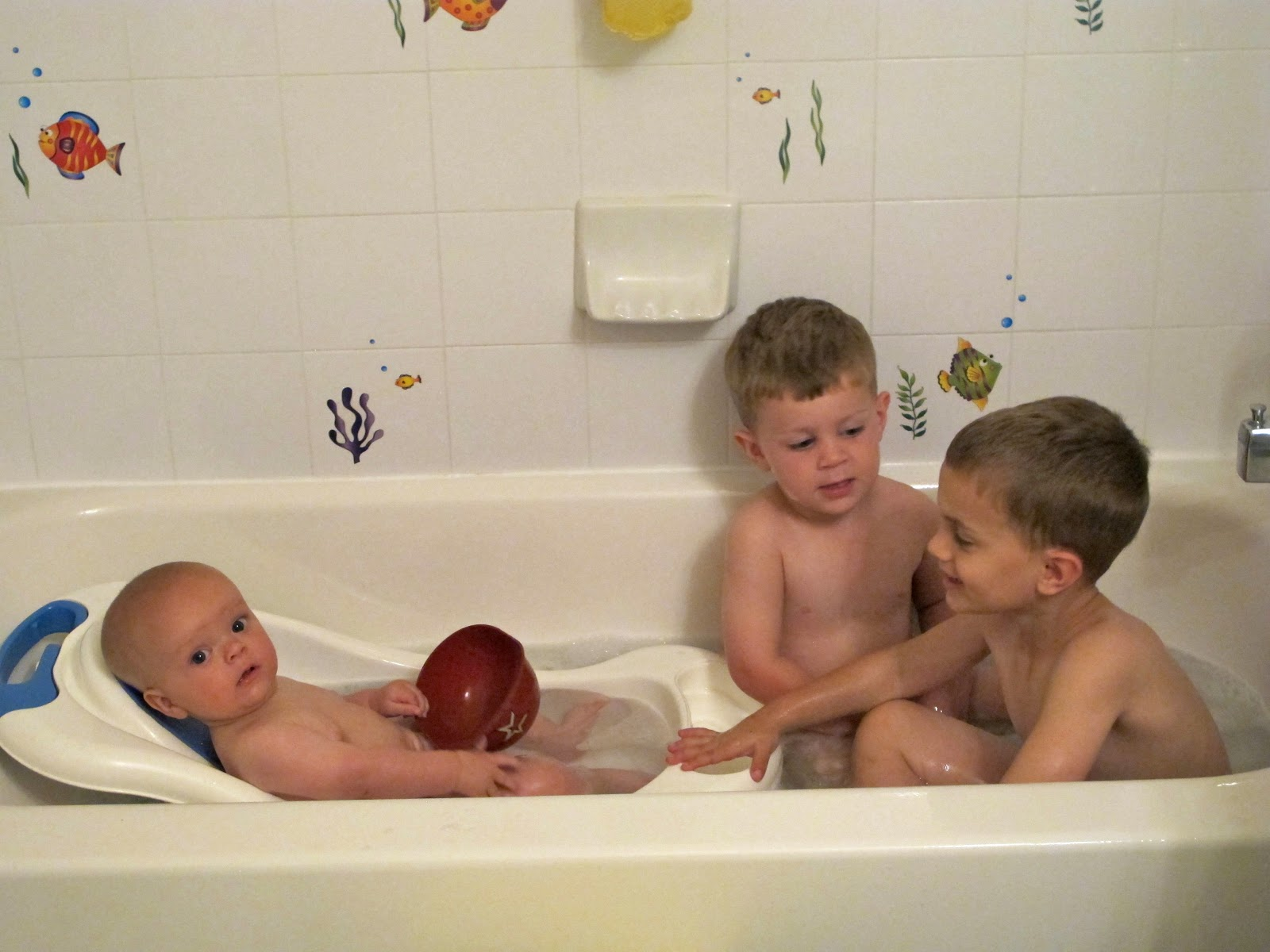 girl and boy naked in the bath
