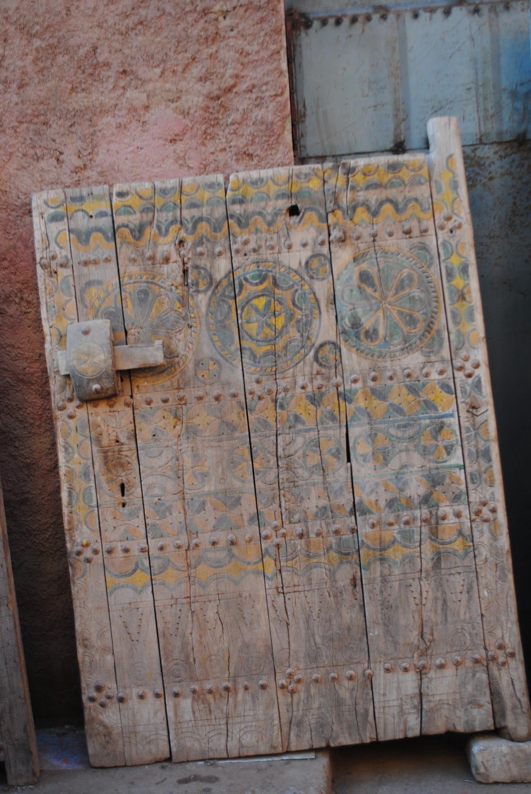 A classic Berber door with a quirky, primitive wooden bolt and lock - Buying Antique Moroccan Doors At The Marrakech Flea Market - Bab El