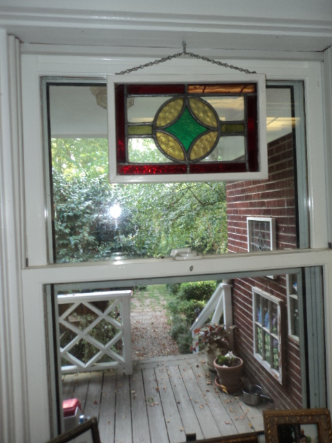 My Small Stained Glass Window I Move Up And Down ( There Is A Hook At  Center Too ), To Be Able To See My Garden Outside.
