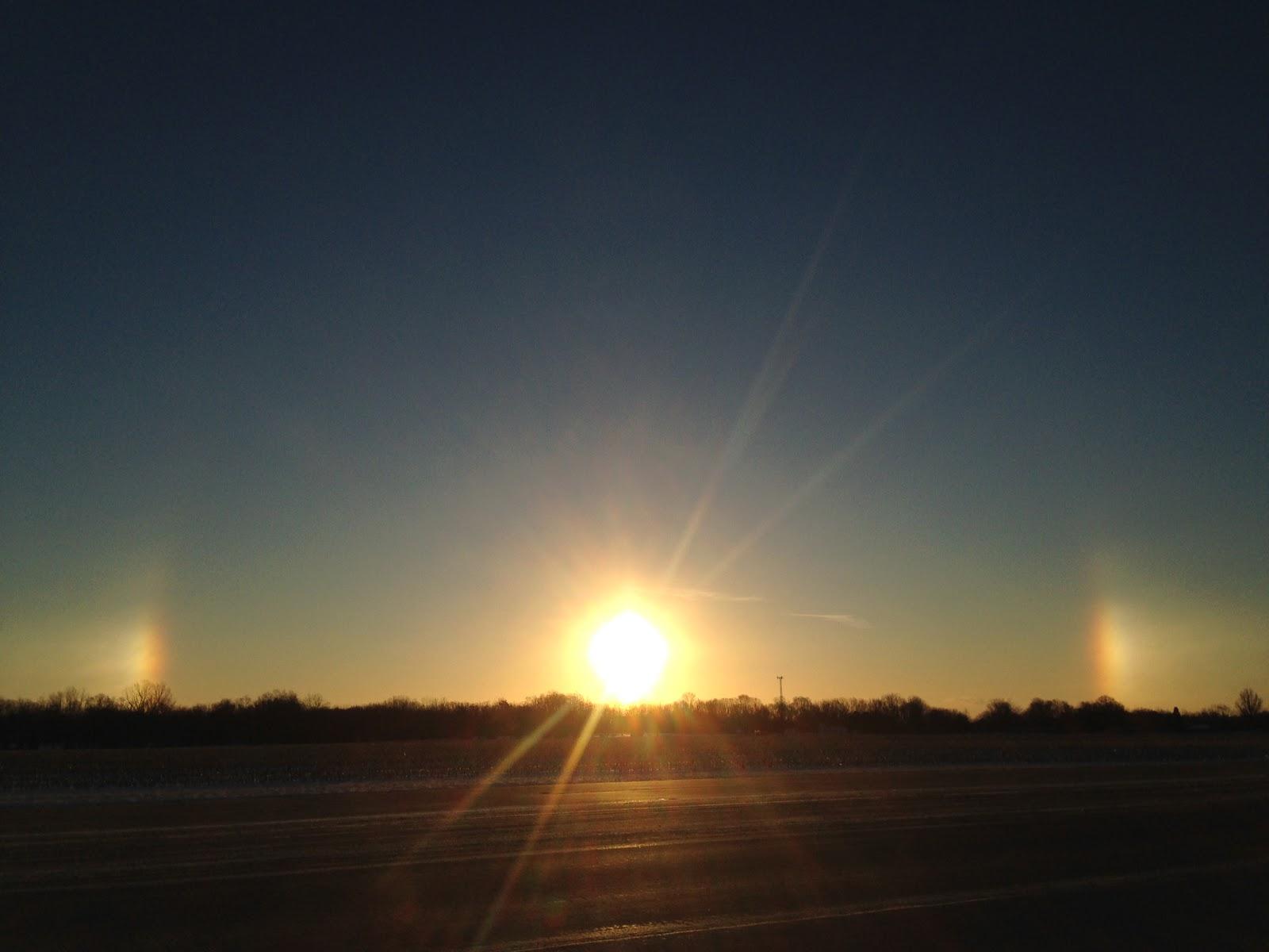 rainbow around the sun lights on both sides