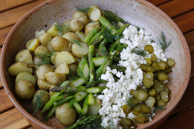A salad of new potatoes, asparagus, feta, dill and gerkins