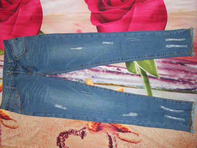 www.shein.com/Blue-Pockets-Ripped-Bleached-Elastic-Denim-Pant-p-175864-cat-1740.html?aff_id=1238