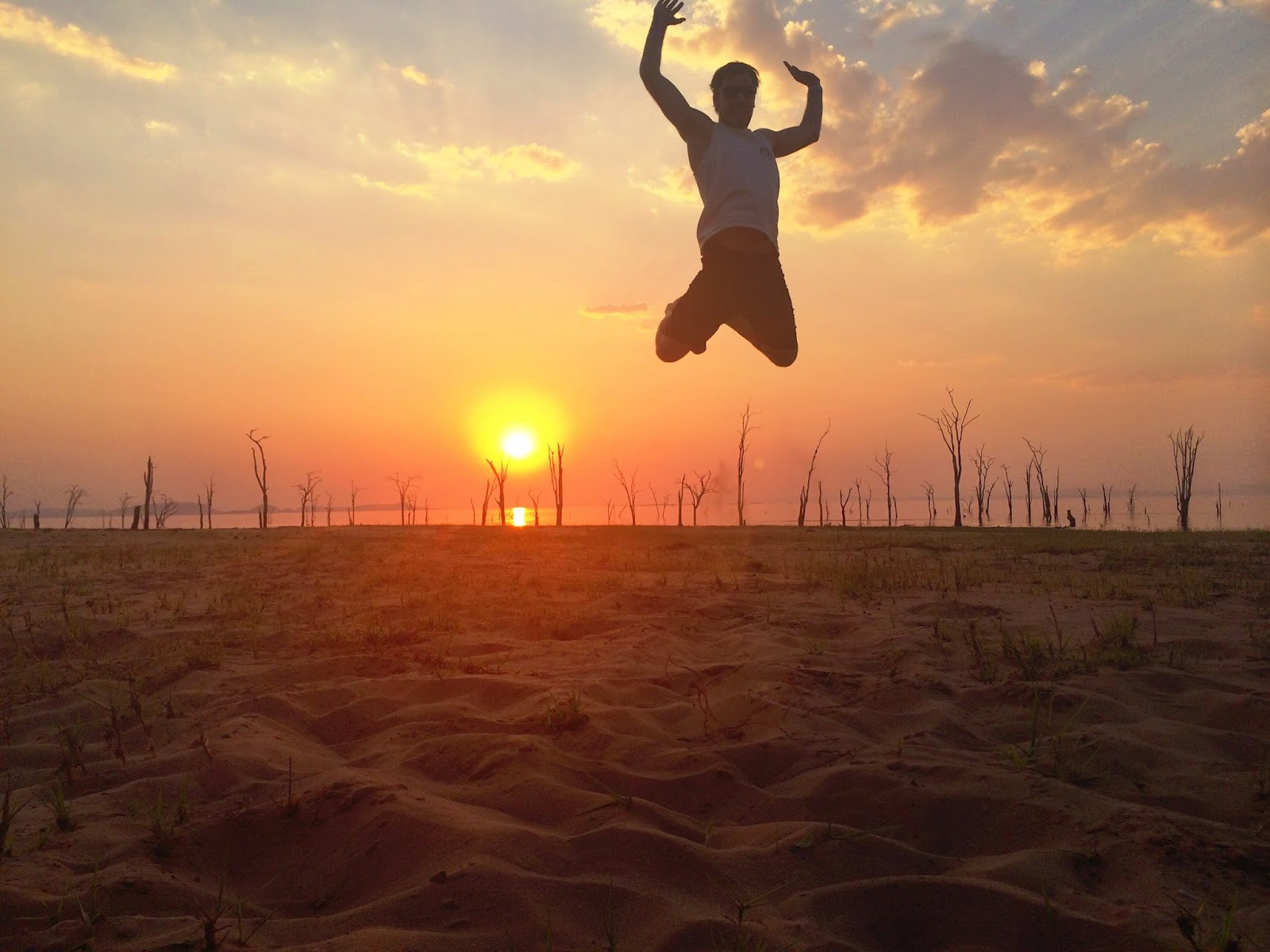 Jumping into the sun - sunset at Rhino Safari Camp