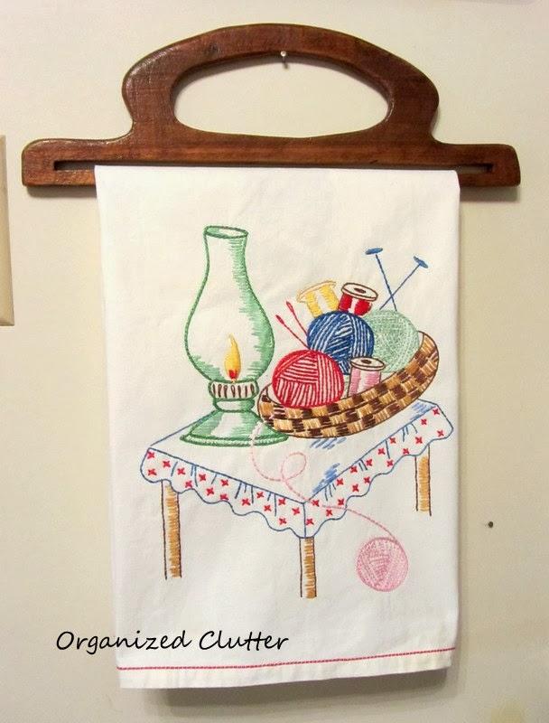 Vintage Purse Handle Tea Towel Holder www.organizedclutterqueen.blogspot.com