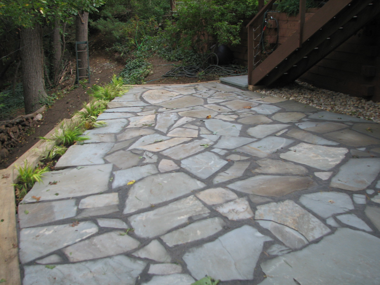 Wikworks inc irregular bluestone patio installation for Pictures of stone patios