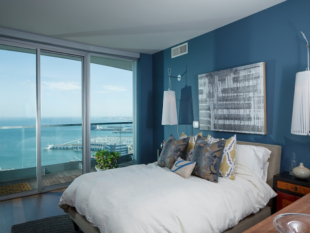 Picture of the contemporary bedroom with large bed and blue wall