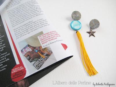 Pagina interna rivista Grazia con orecchini asimmetrici