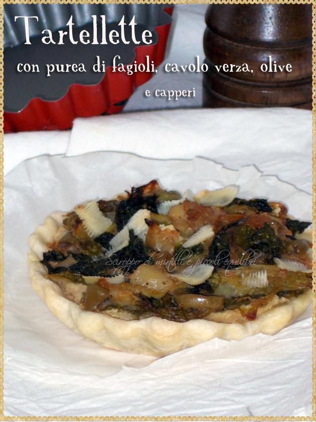 Tartellette con purea di fagioli, cavolo verza, olive e capperi