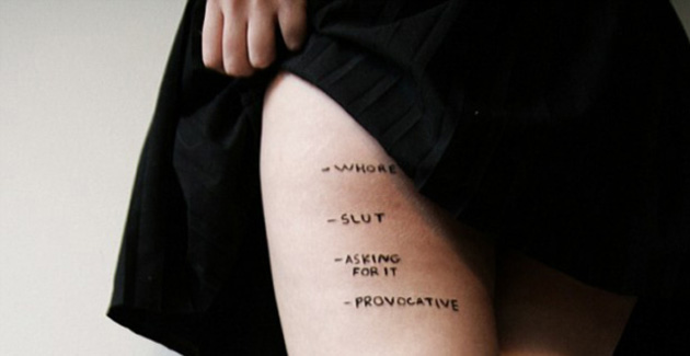 women's legs wearing a black skirt