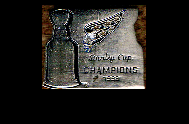 You read the pin right;  these were made in case the Caps had beaten Detroit in the 1998 Finals; now they're proudly worn in some third-world country.