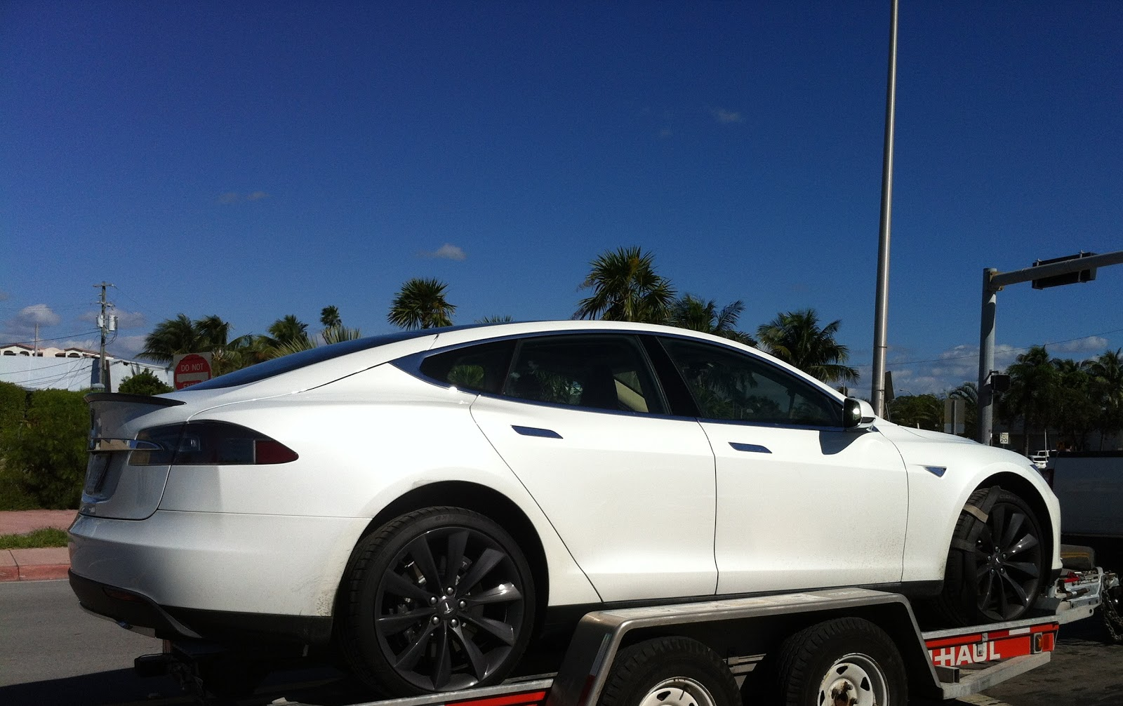 white tesla model s with black rims exotic cars on the streets of miami