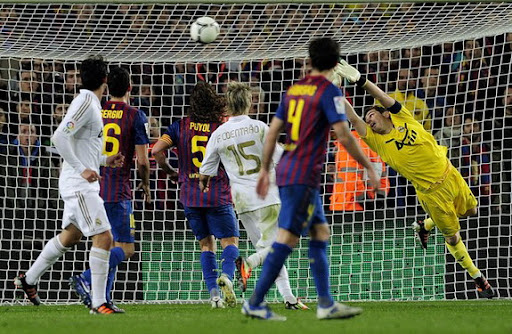 Real Madrid goalkeeper Iker Casillas fails to stop a goal from Barcelona player Daniel Alves