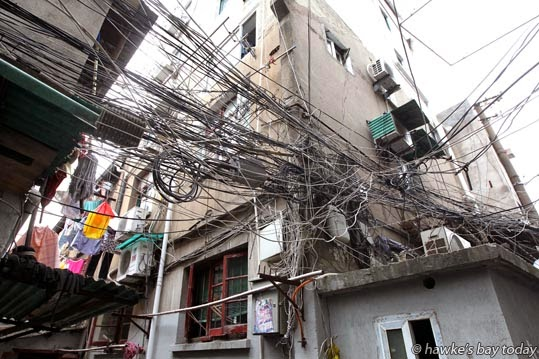 Spaghetti-like power-lines which may or may not be live photograph