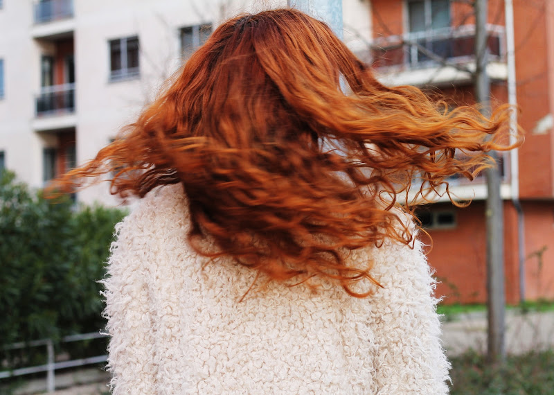 red curly hair twirling