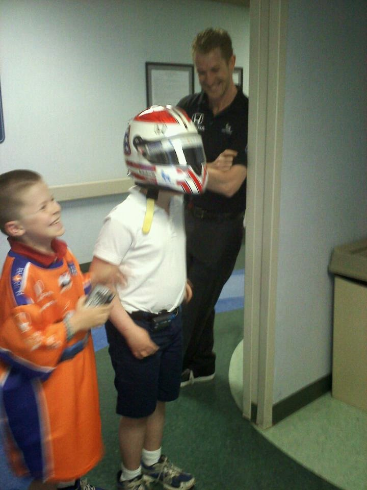 Nathan poses with Indy car racer Charlie Kimball during a visit to Fort Wayne's Lutheran Children's Hospital