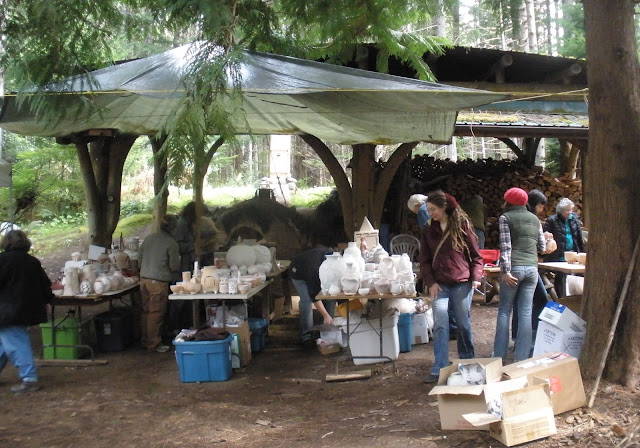 108 buddhas ceramics loaded by artists into anagama dragon kiln, an ancient japanese design