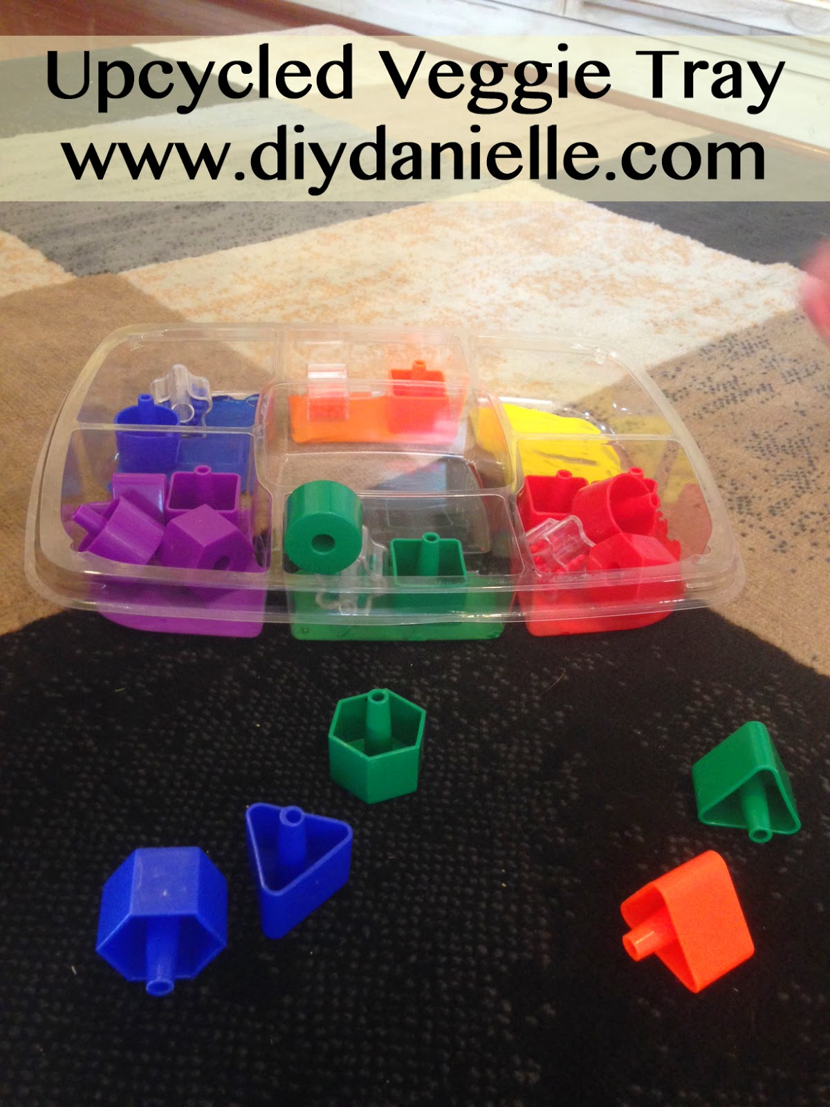 How to upcycle a vegetable tray into a learning activity for toddlers.