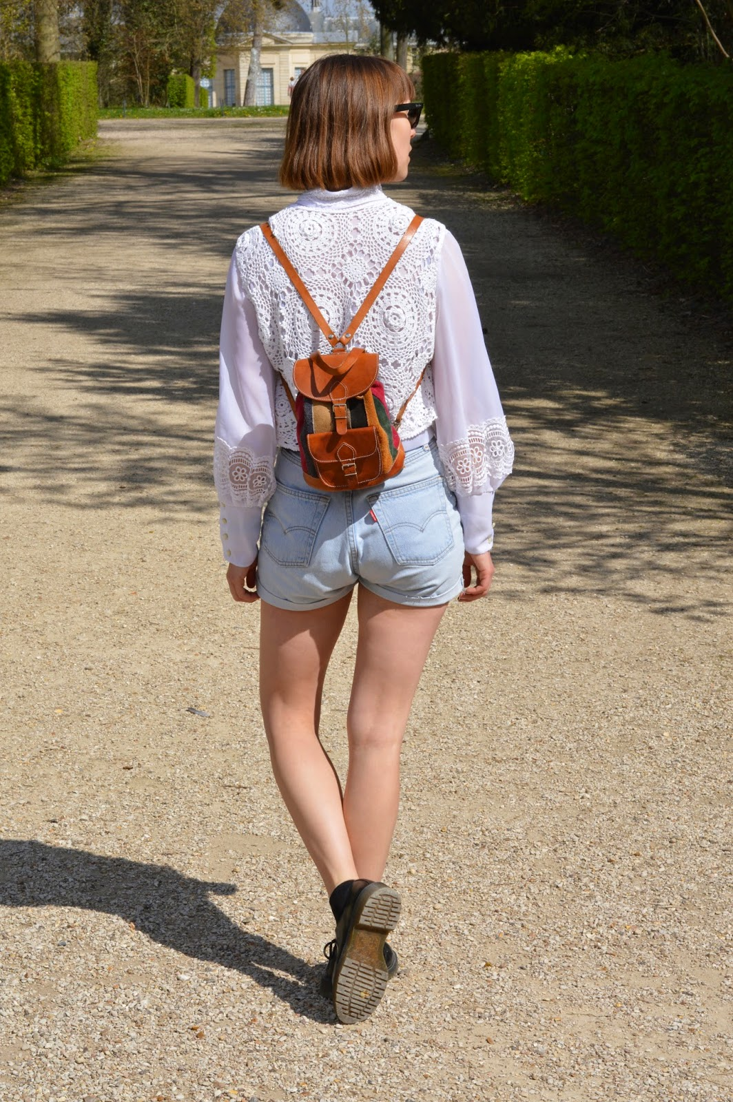 White lace shirt and suede backpack