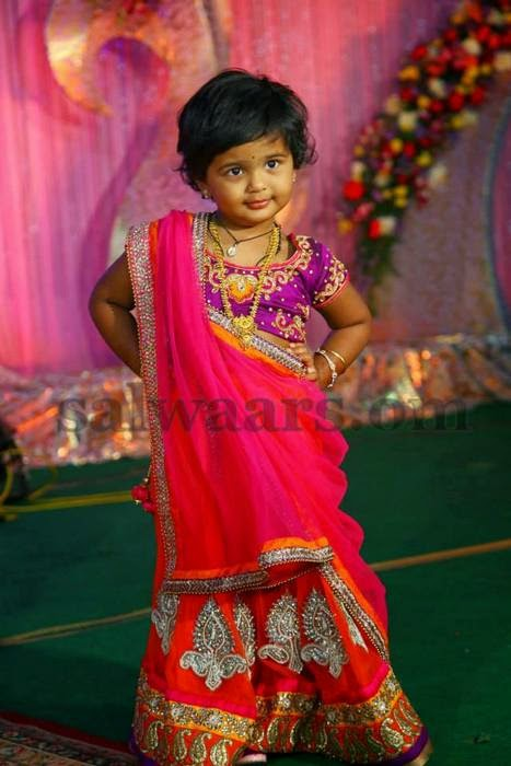 Girl in Orange and Pink Half Saree