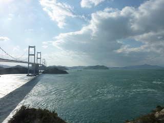 The Kurushima-Kaikyo bridge stretching into the distance as seen Oshima island on the Shimanami Kaido bikeway.
