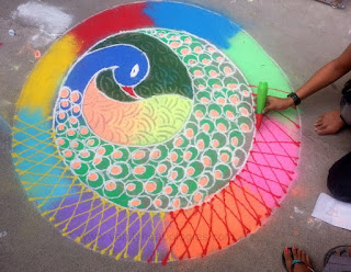making rangoli on uttarayan