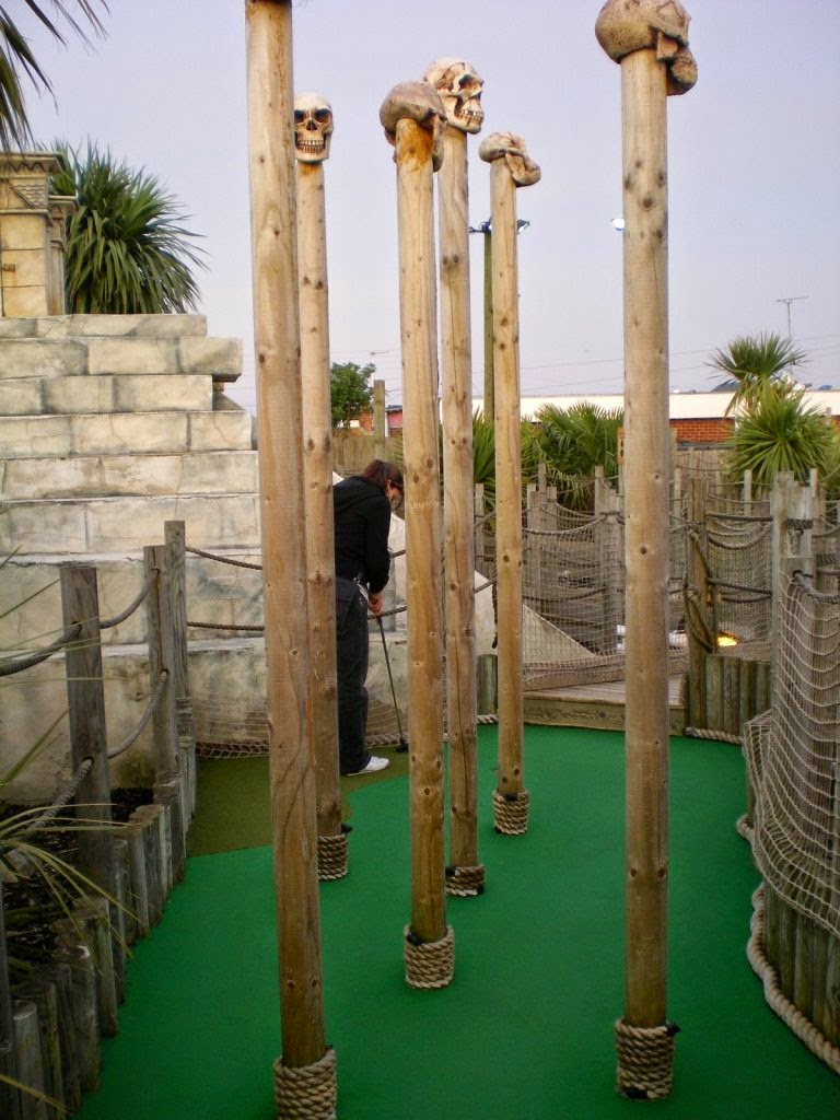 Emily Gottfried in amongst the skulls on spikes at the Lost World Adventure Golf course in Hemsby