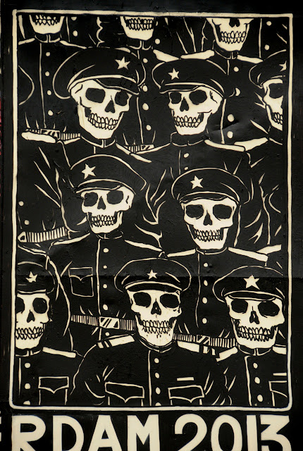 details of street art piece by broken fingaz in amsterdam - skulls with hats