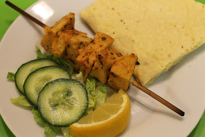 Vegetarian kebabs on a plate with salad