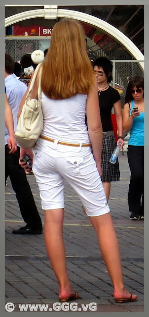 Girl in white breeches on the street