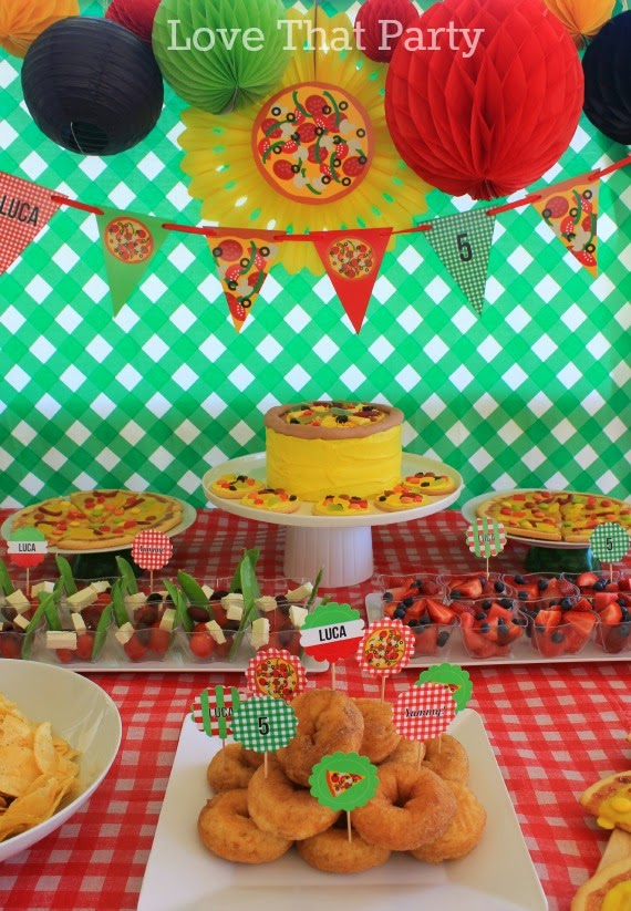 Pizza party table pizzeria party food bunting pizza cake honeycomb balls paper fans penant flags